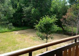 Terraza y jardin casa del lago